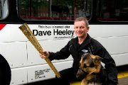 Blind Dave and Seamus the dog with the new bus named in his honour