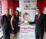 National Express Dundee drivers Ross Murdoch and Allan Fordyce with Cash for Kids Assistant Alison Carr